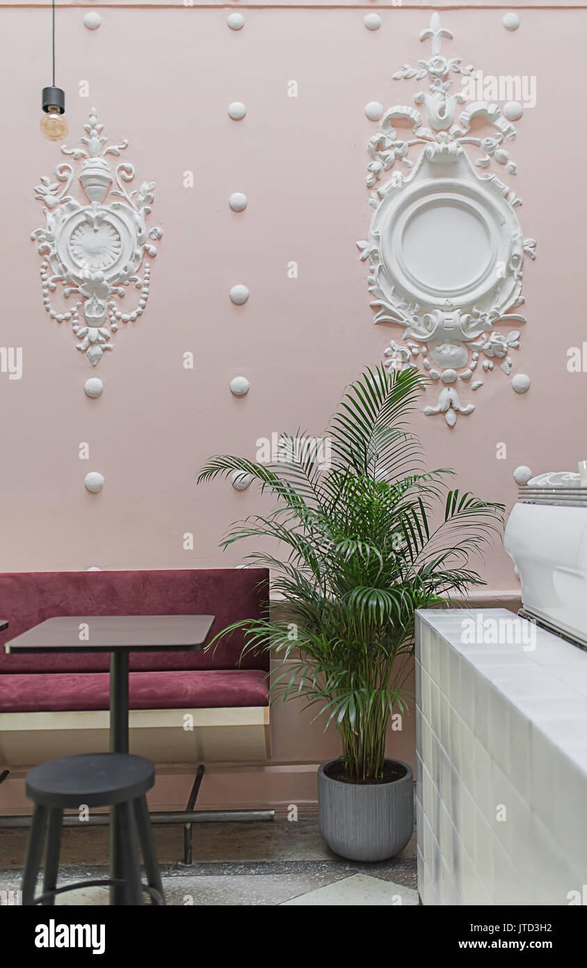 Restaurant With White Stucco Molding On The Pink Wall And A Tiled Stock Photo Alamy