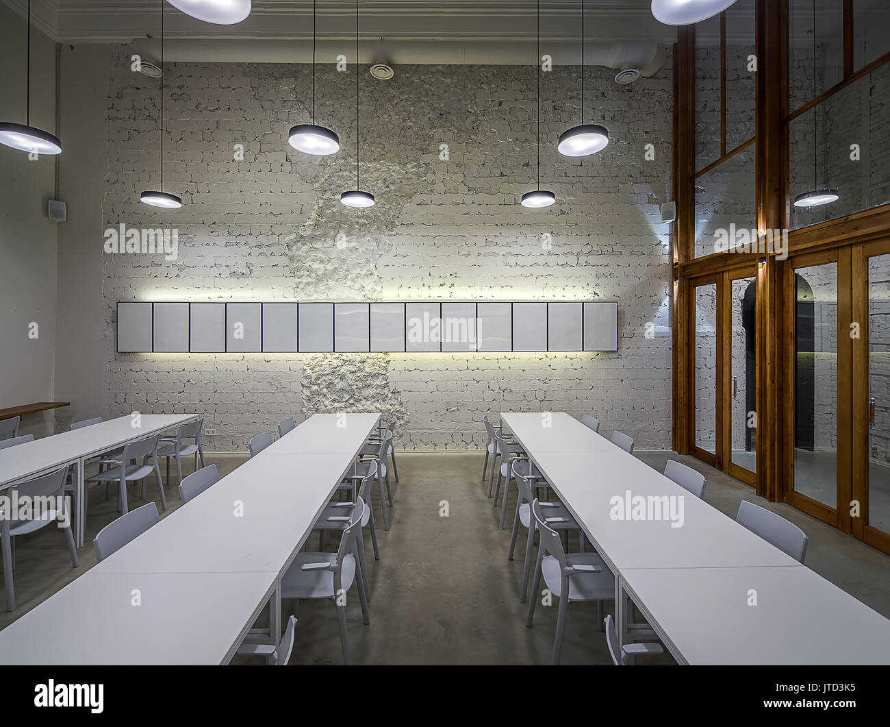 luminous hall in the cafe with shabby light walls and gray floor stock photo 152722953 alamy. Black Bedroom Furniture Sets. Home Design Ideas