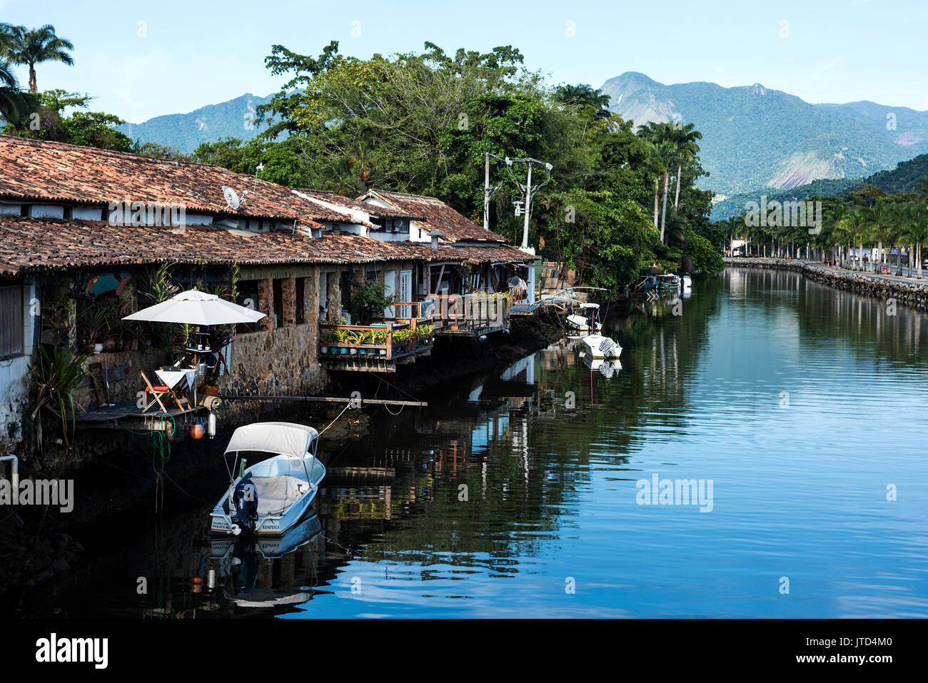 Paraty, Brazil - February 24, 2017: An iconic view of the canal and the colonial houses of the historic town Paraty, Rio de Janeiro state, Brazil - Stock Image