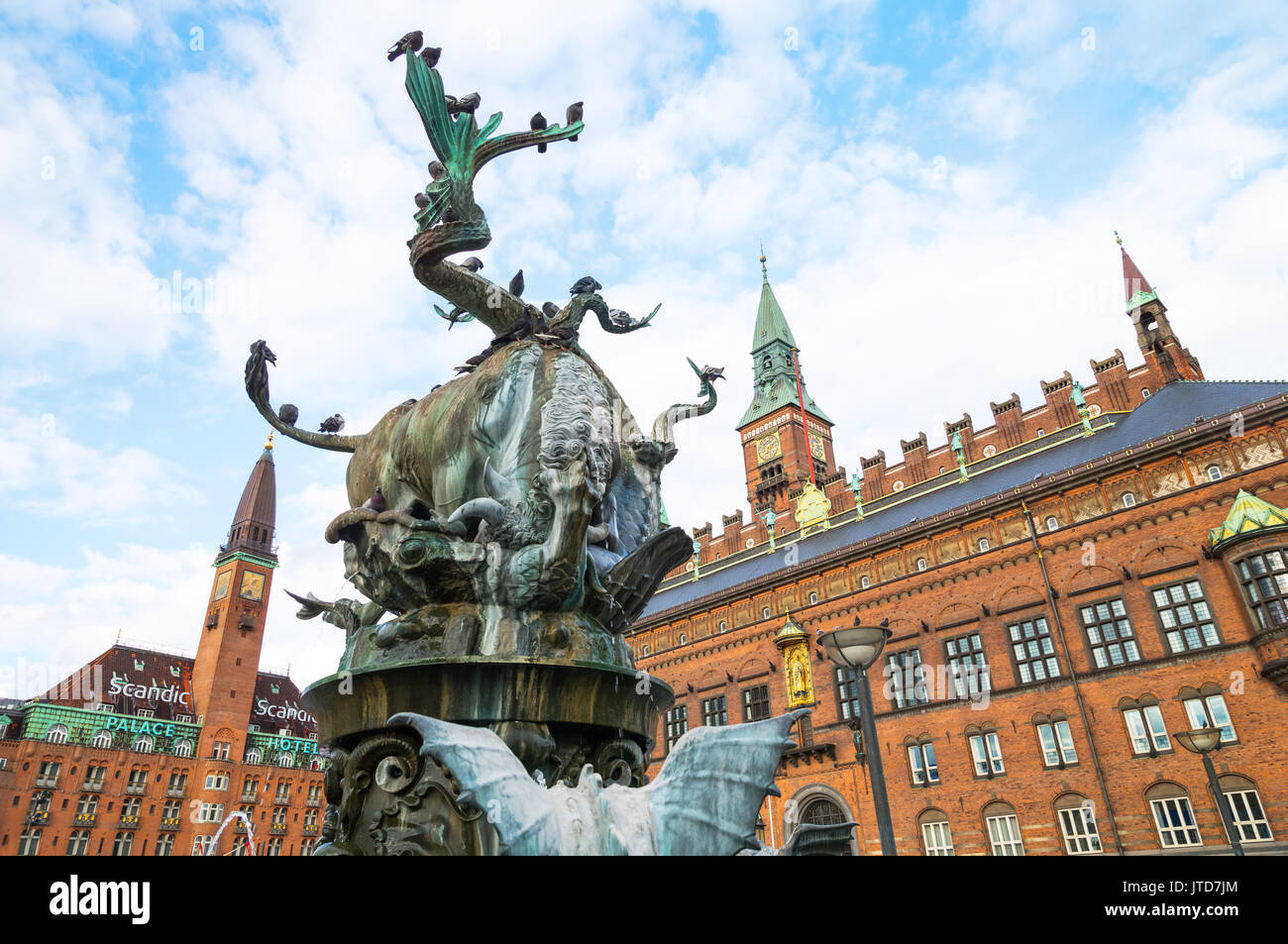 Copenhagen, Denmark, The City Hall Palace and Clock Tower with the Bull and Dragon fountain in the foreground - Stock Image