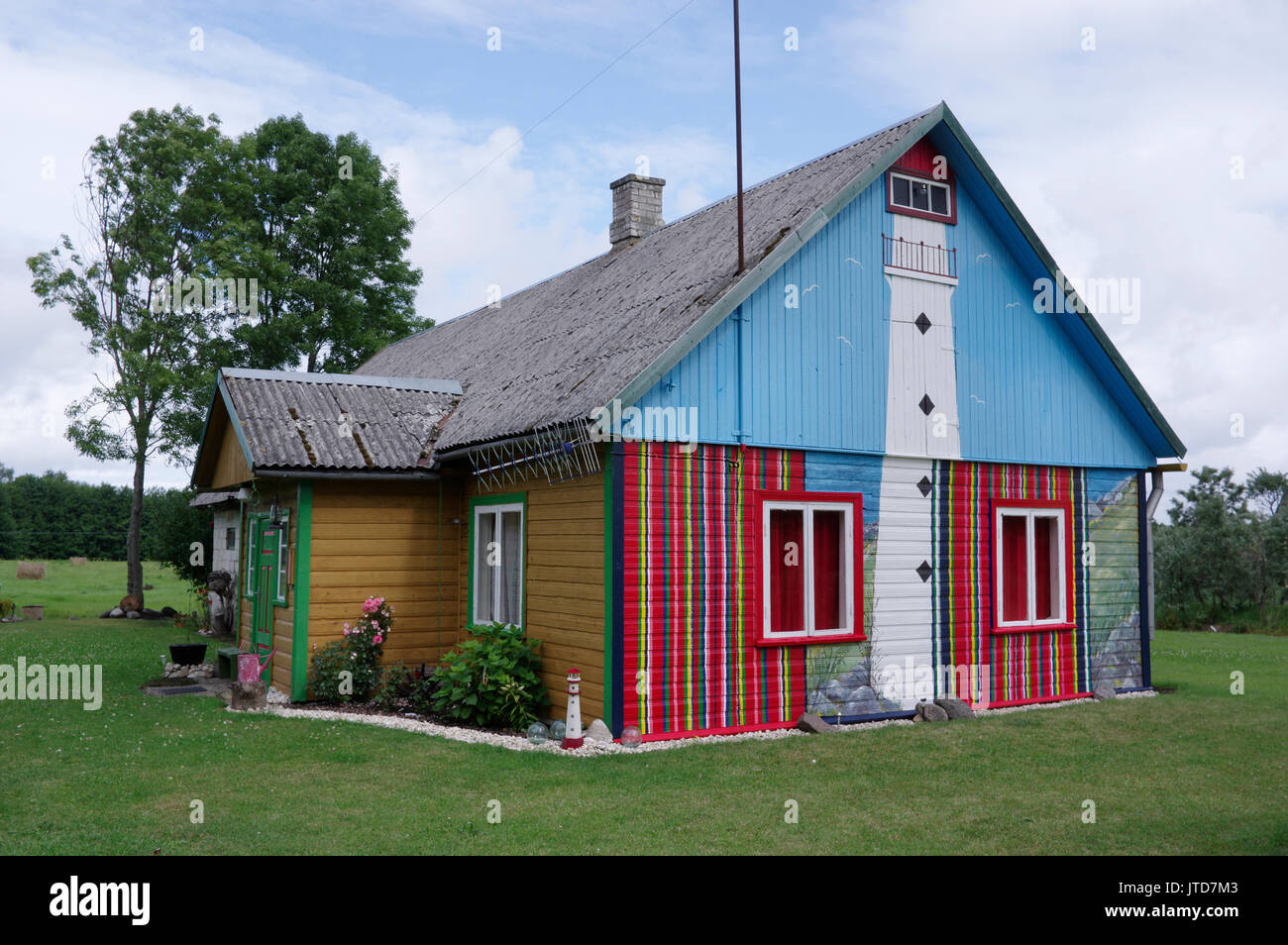 The facade of the House painted Kihnu skirt colors. Kihnu Island, Estonia 5th August 2017 Stock Photo