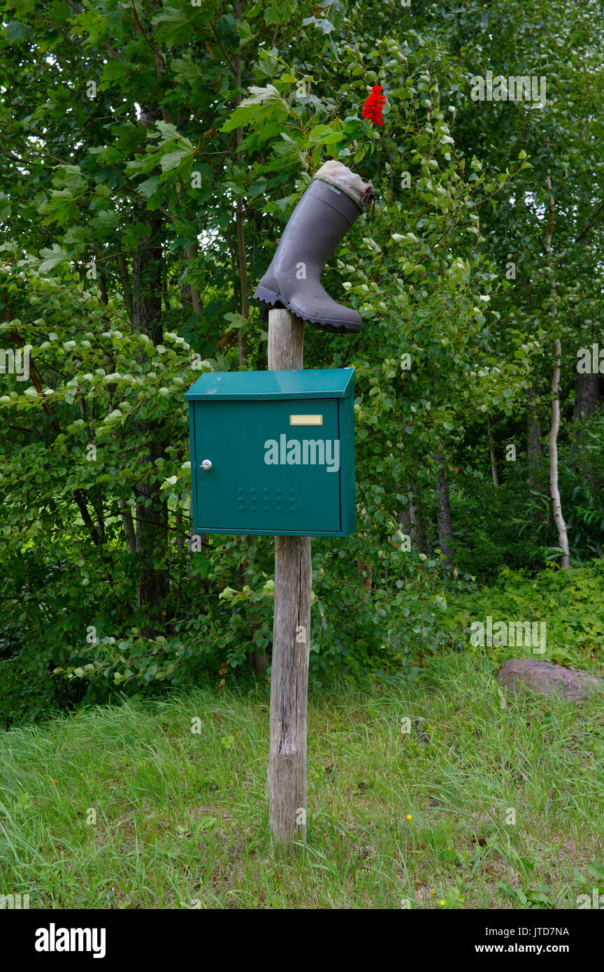 Kihnu post box decorated with a boot and a flower. Island Kihnu, Estonia 5th August 2017 Stock Photo