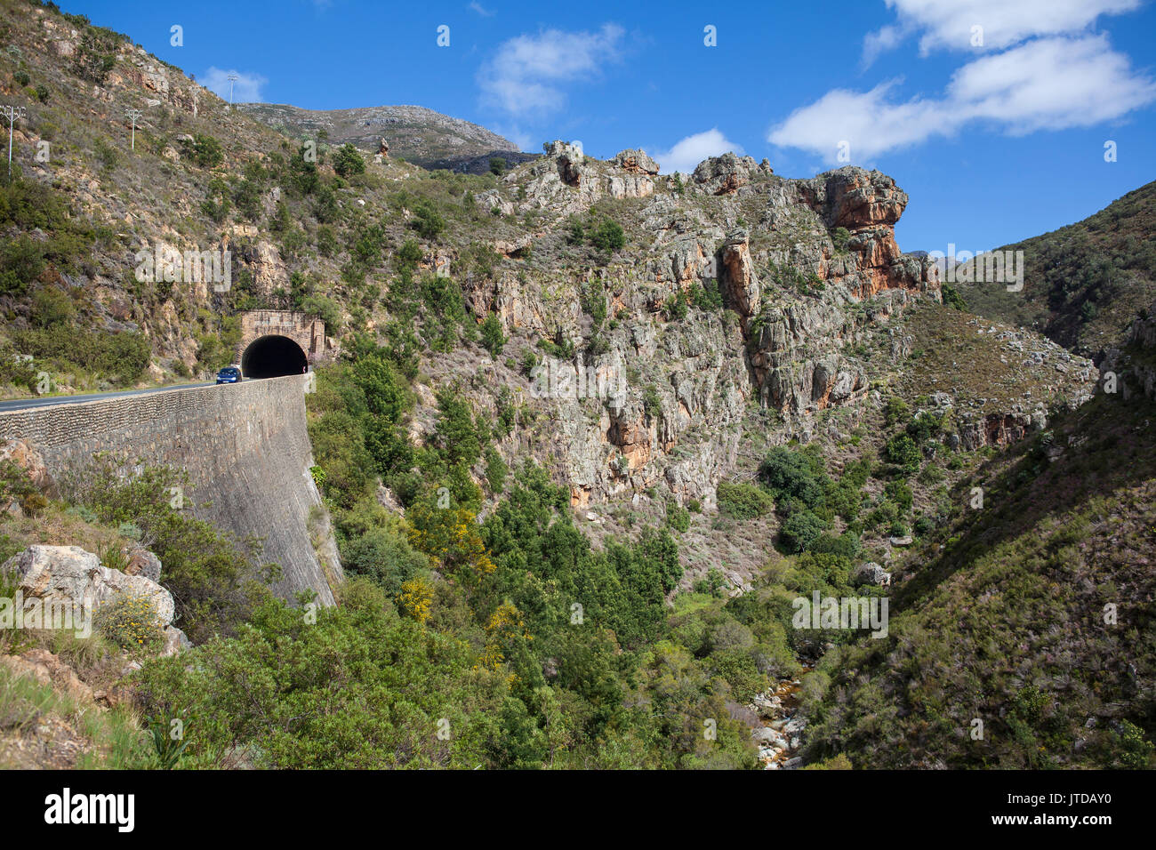 The old Du Toits Kloof Tunnel built by Italian prisoners of war exits high above the river and into spectacular Stock Photo