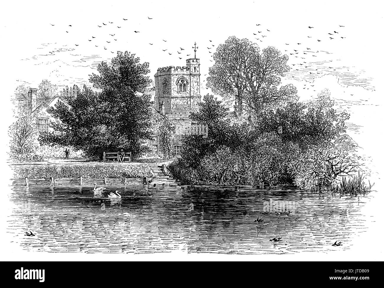 1870:  Viewed from across the River Thames, the ancient and historic church of St Michael's. It dates from 1293 and was partly rebuilt ca. 1500 and extensively restored 1857–82 by Thomas Henry Wyatt. Located in the Parish of Bray, Berkshire, England. It was made famous (or infamous!) in the popular ballad, the parish is widely known, because of the turncoat ways of the Vicar of Bray. - Stock Image