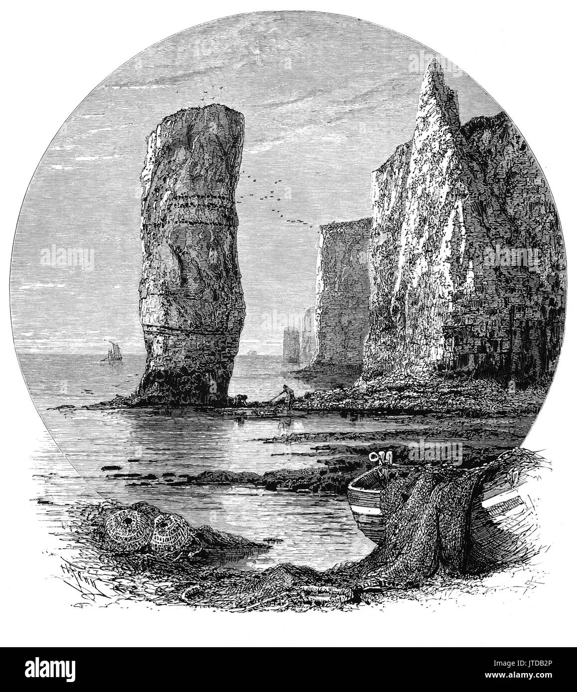 1870: Fishermen and boats near Old Harry Rocks, chalk formations, including a stack and a stump, located at Handfast Point, on the Isle of Purbeck in Dorset, England. They mark the most easterly point of the Jurassic Coast, a UNESCO World Heritage Site. - Stock Image