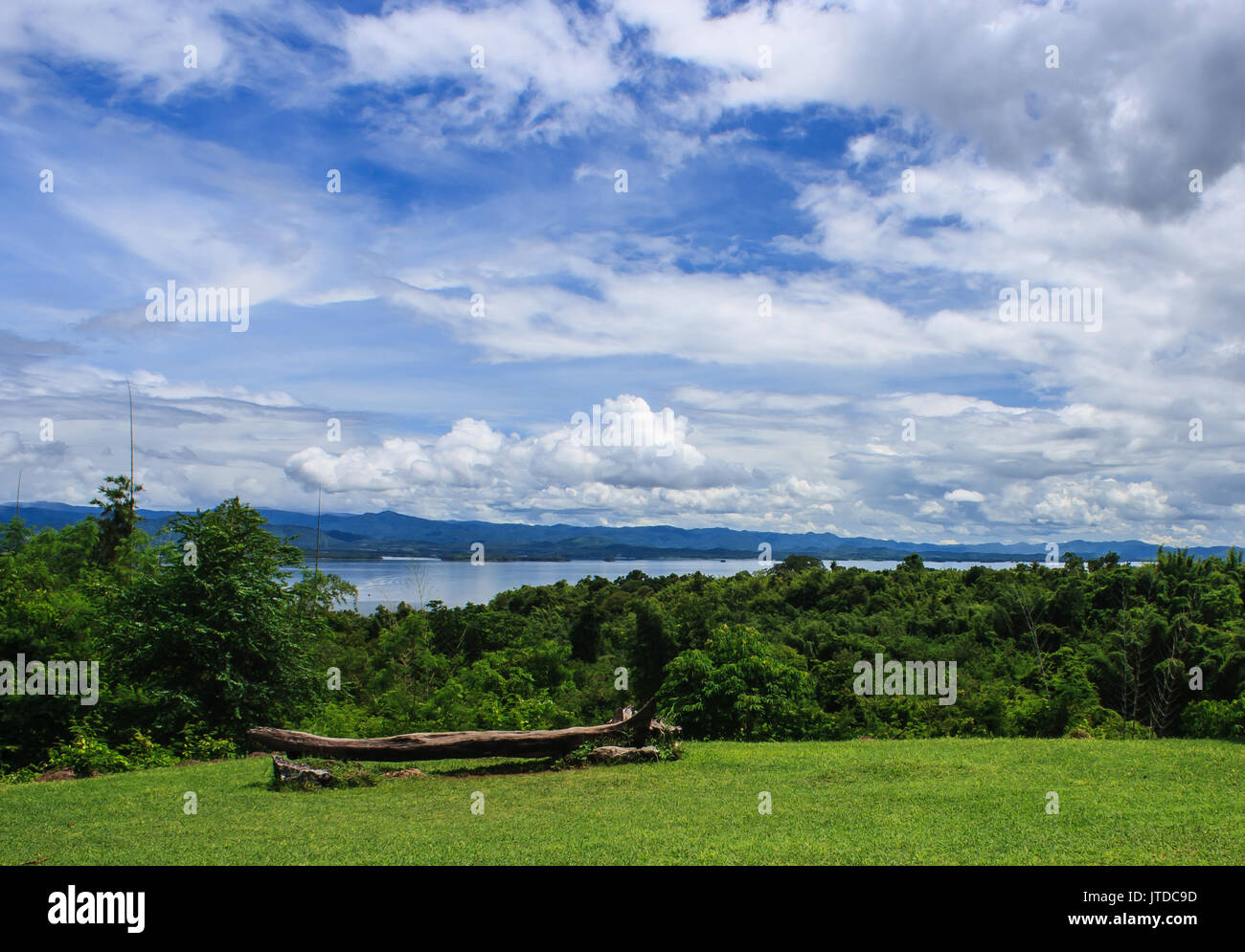 beautiful garden in front of blue Srinakarin dam with clear blue sky, Kanchanaburi province, Thailand - Stock Image