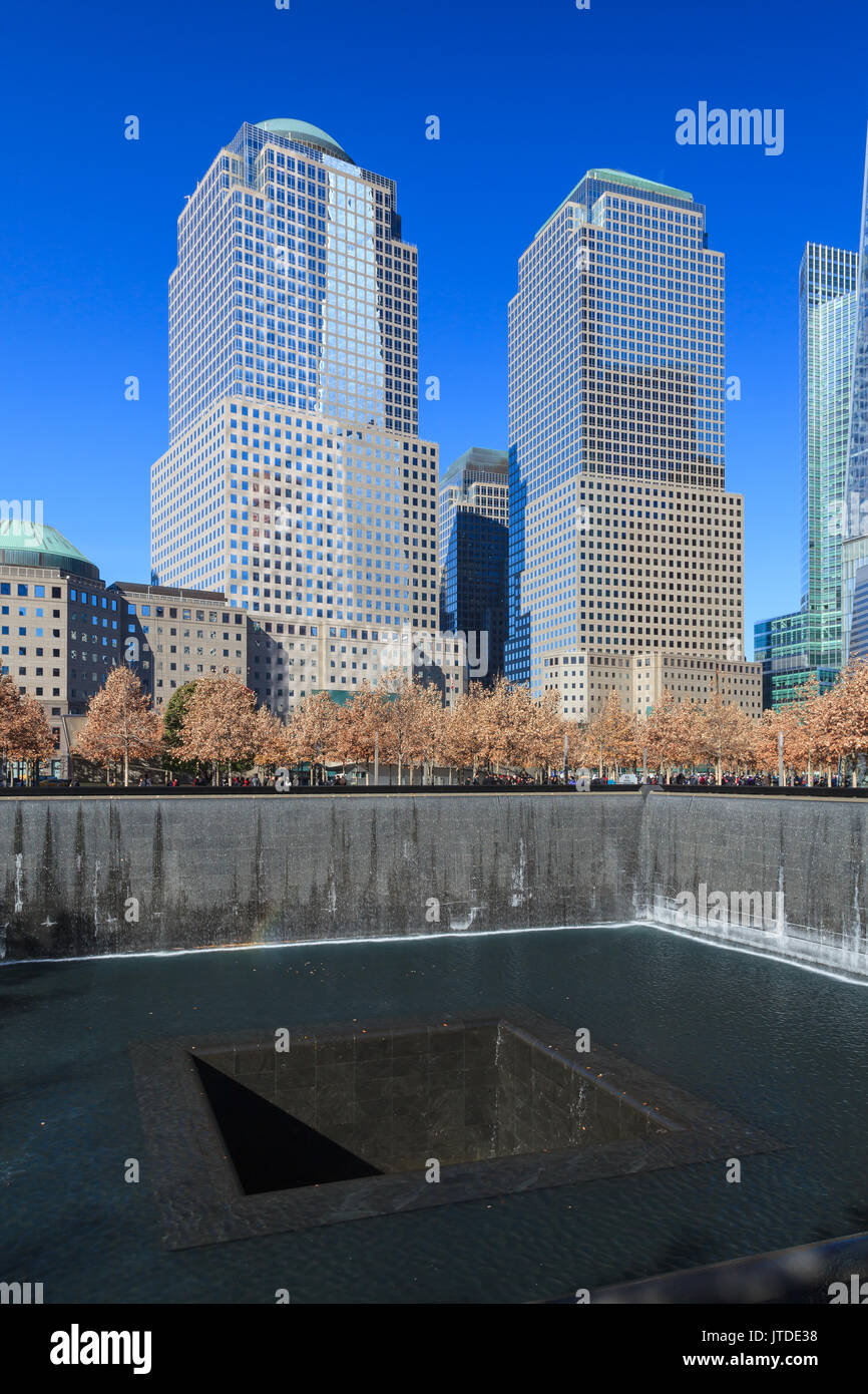 The view across the 9/11 Memorial site to Two and Three World Financial Centers in New York City. Stock Photo