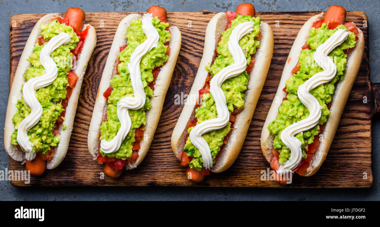 e6eb48ee19 Chilean Completo Italiano. Hot dog sandwich with tomato, avocado and  mayonnaise. Top view, copy space