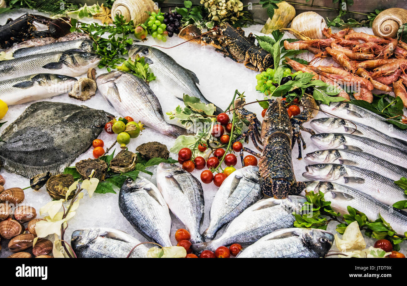 Fresh raw seafoods on counter in restaurant. Food theme. Mediterranean specialties. - Stock Image