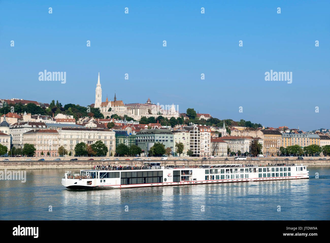 Viking River Cruises boat on the River Danube with Matthias Church and Fishermen's Bastion on Castle Hill behind, Budapest, Hungary - Stock Image