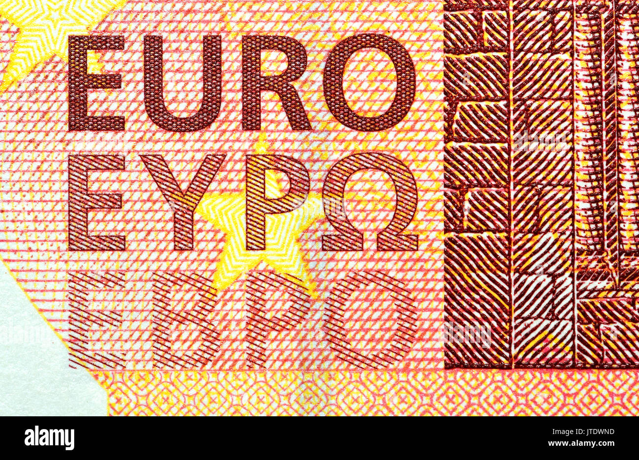 €10 banknote detail showing the word 'Euro' in three alphabets - Roman (Latin), Greek and Cyrillic - Stock Image