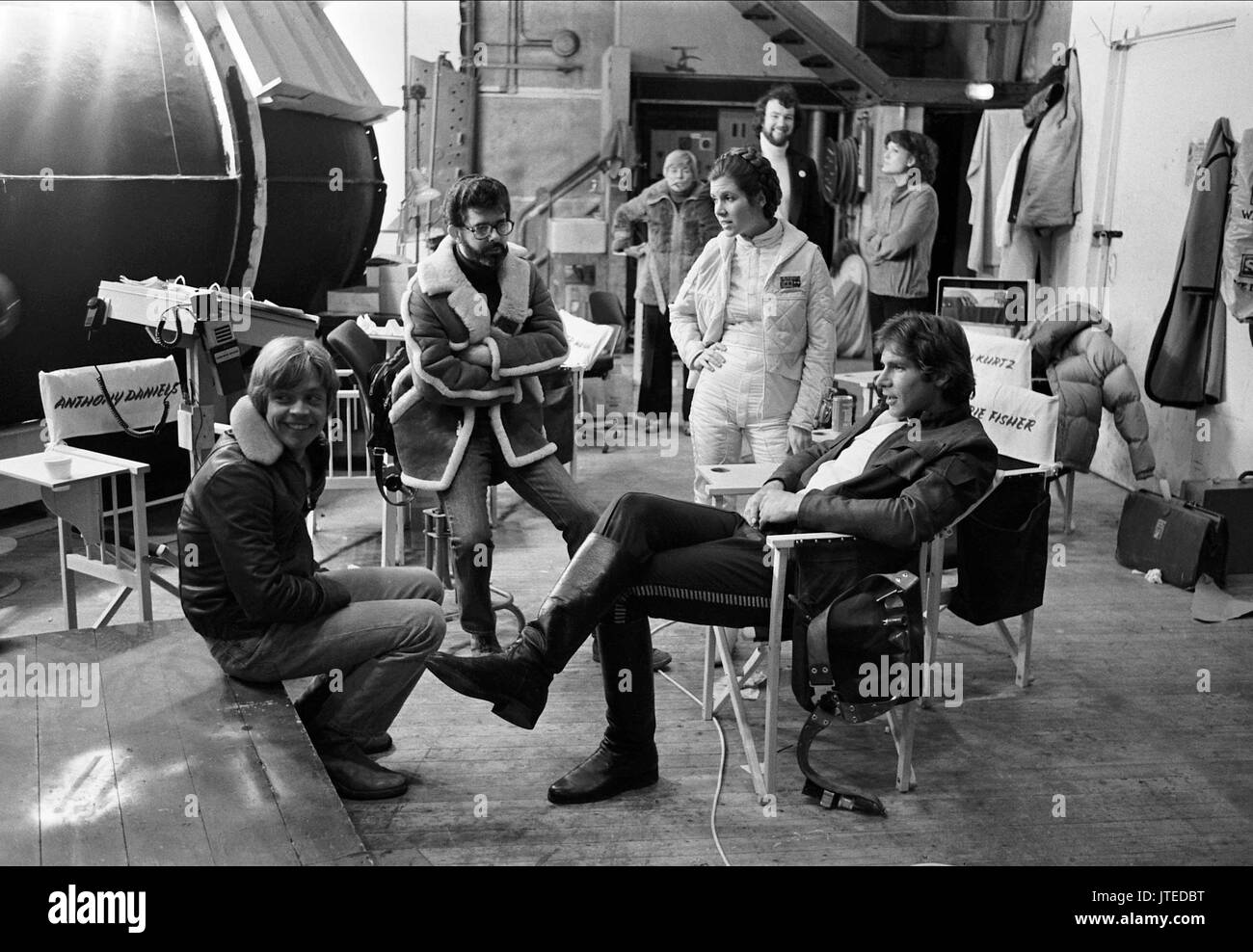 MARK HAMILL, GEORGE LUCAS, CARRIE FISHER, HARRISON FORD, STAR WARS: EPISODE V - THE EMPIRE STRIKES BACK, 1980 - Stock Image