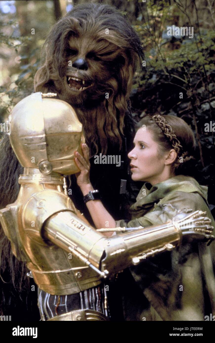 ANTHONY DANIELS PETER MAYHEW & CARRIE FISHER STAR WARS: EPISODE VI - RETURN OF THE JEDI (1983) - Stock Image