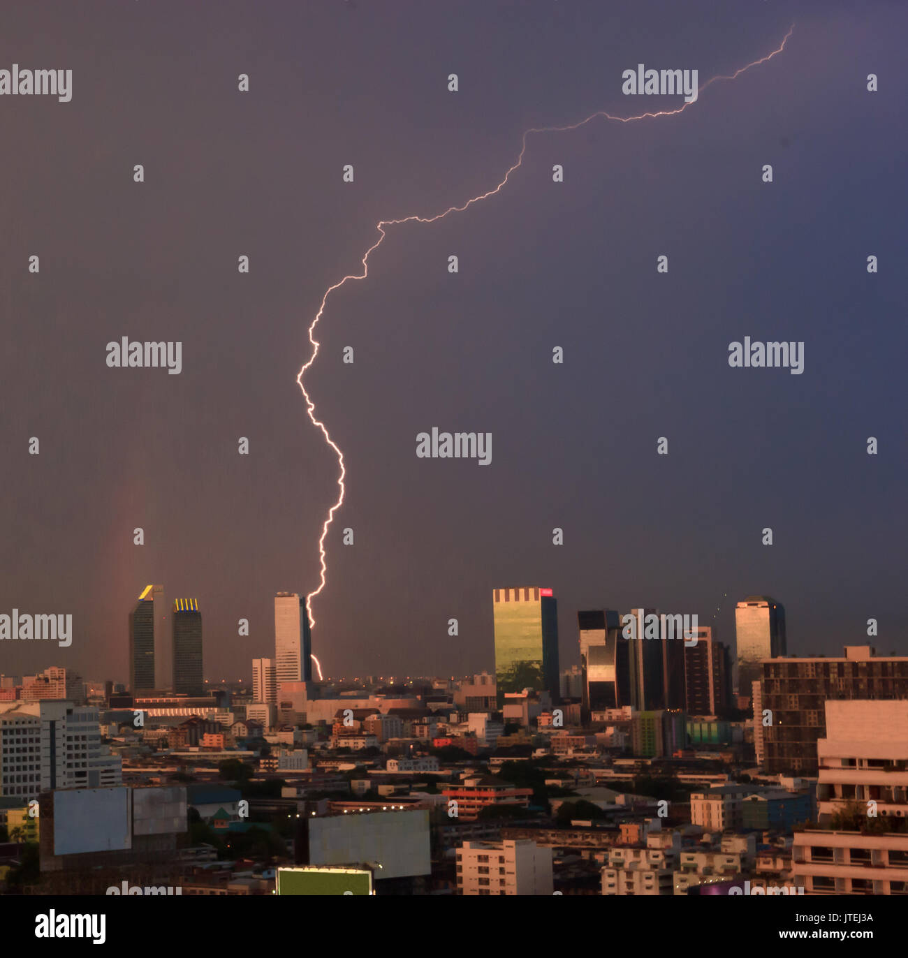 Urban View of Natural Phenomena, Lightning and Rainbow over the city's central business district, bangkok, capital of Thailand, Southeast Asia - Stock Image