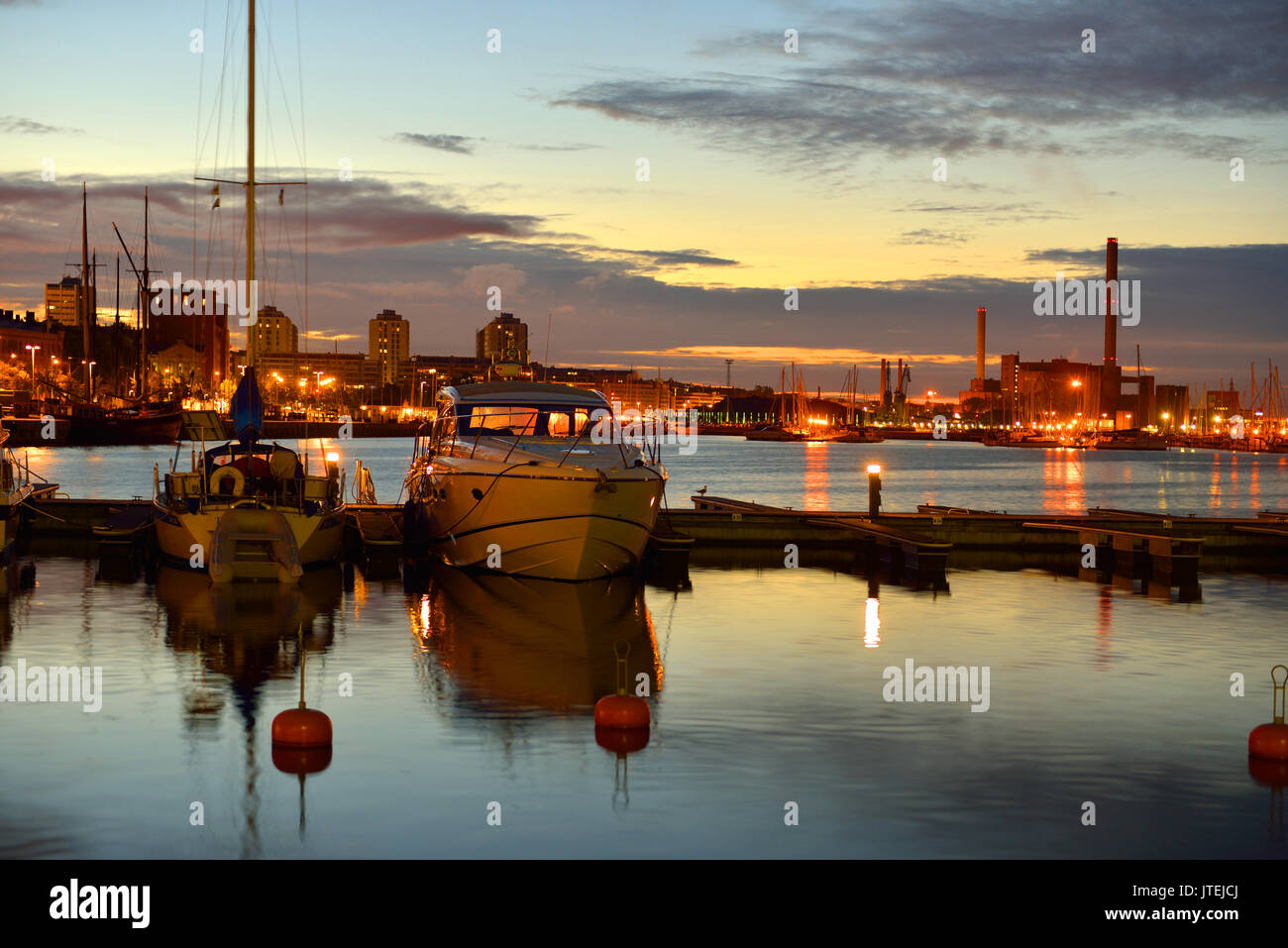 Sunset in Helsinki. Ships and yachts sleep in harbor Stock Photo