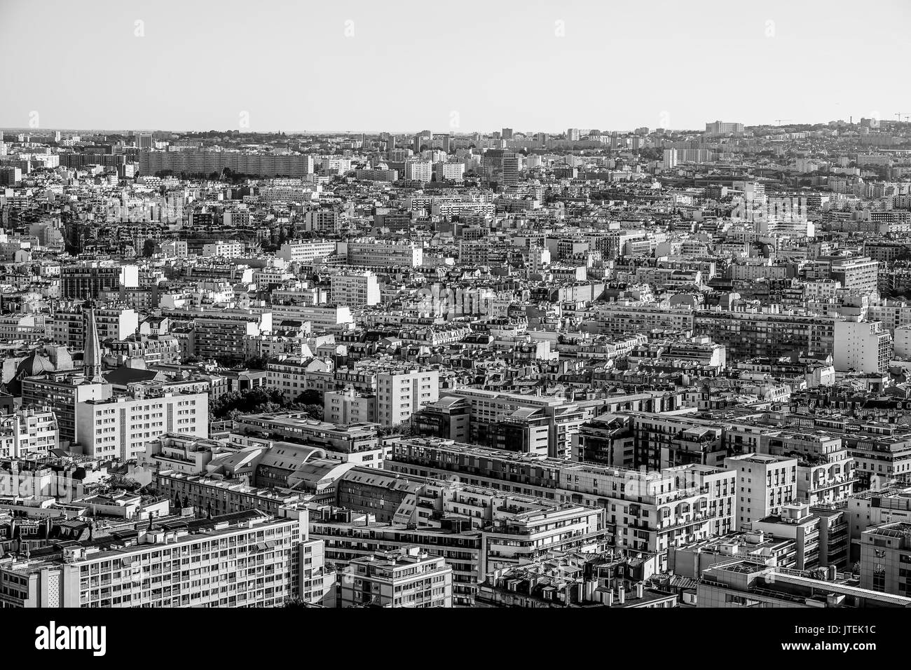 Wide angle view over the city of Paris on a hot summer day - aerial shot - Stock Image