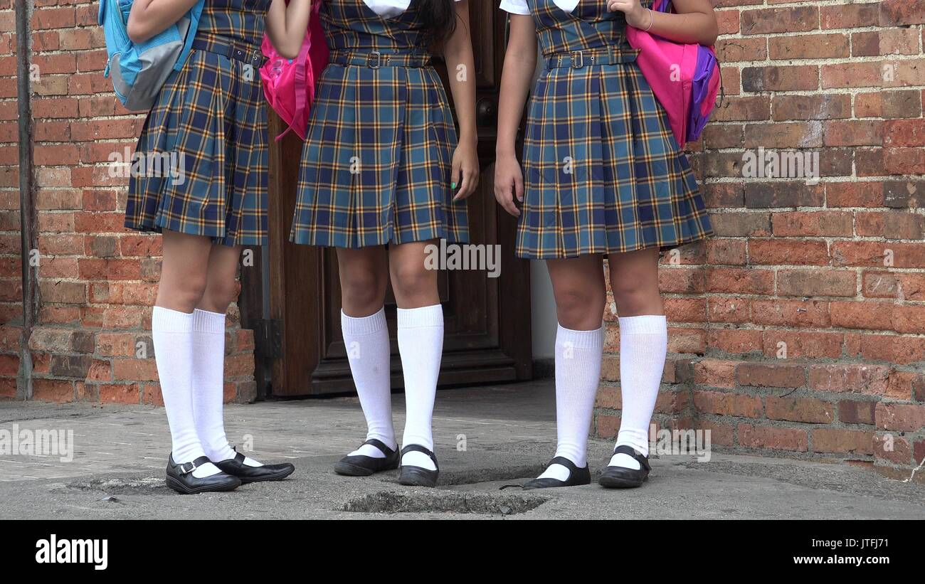 Female Students Wearing Skirts Or Dresses - Stock Image