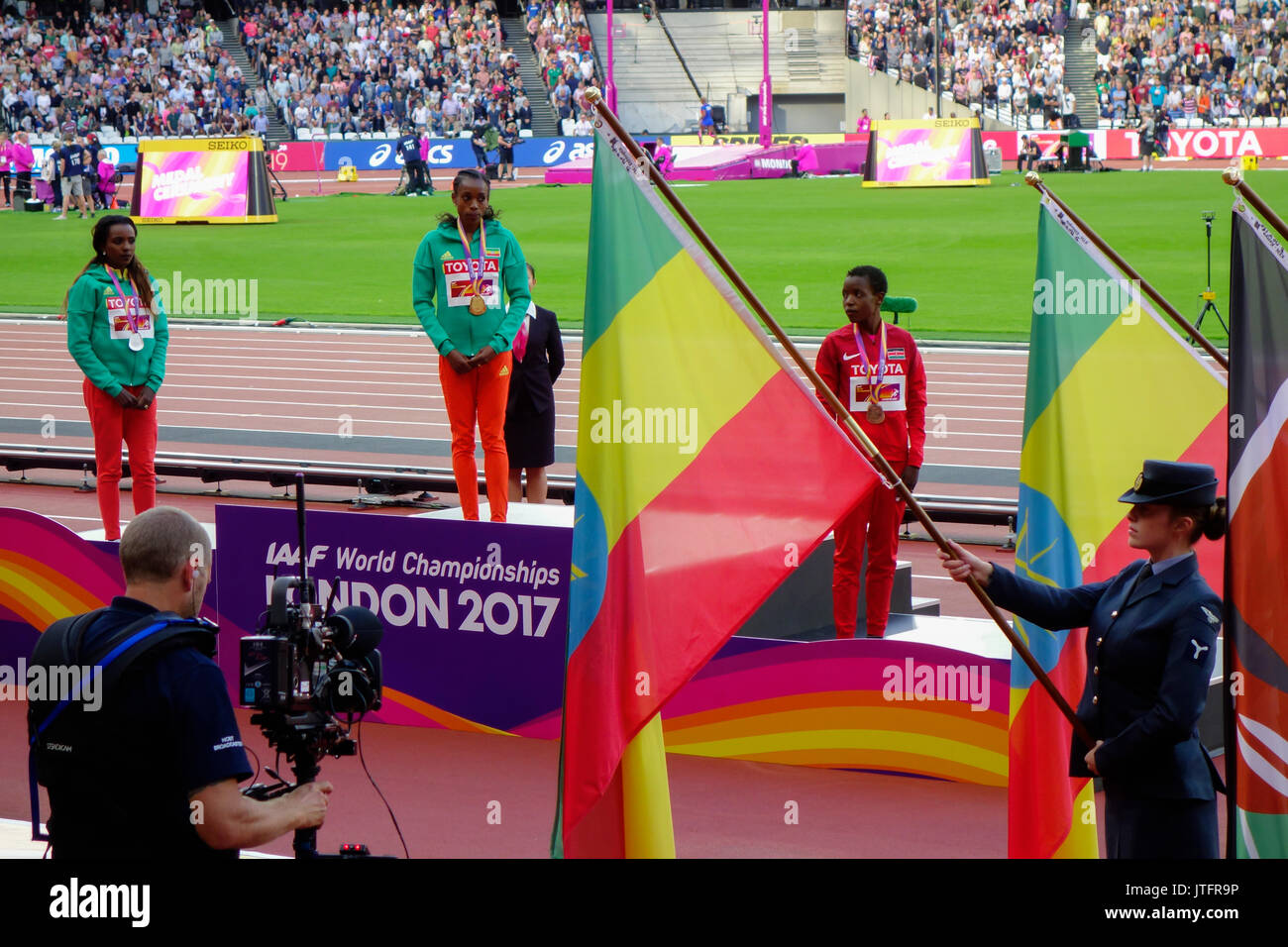 Tirunesh Dibaba of Ethiopia, silver, Almaz Ayana of Ethiopia, gold and Agnes Jebet Tirop of Kenya, bronze at IAAF World Championships London 2017. - Stock Image