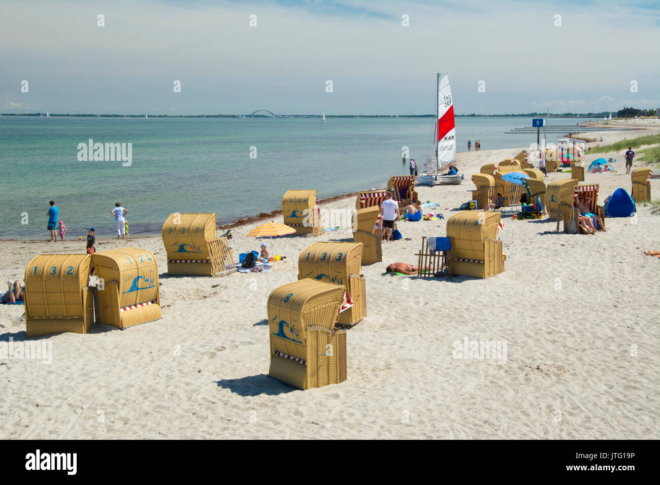Strandkorbe or beach shelters at Steinwarder Beach at Heiligenhafen on the Ostsee or Baltic coast, Holstein, Germany - Stock Image