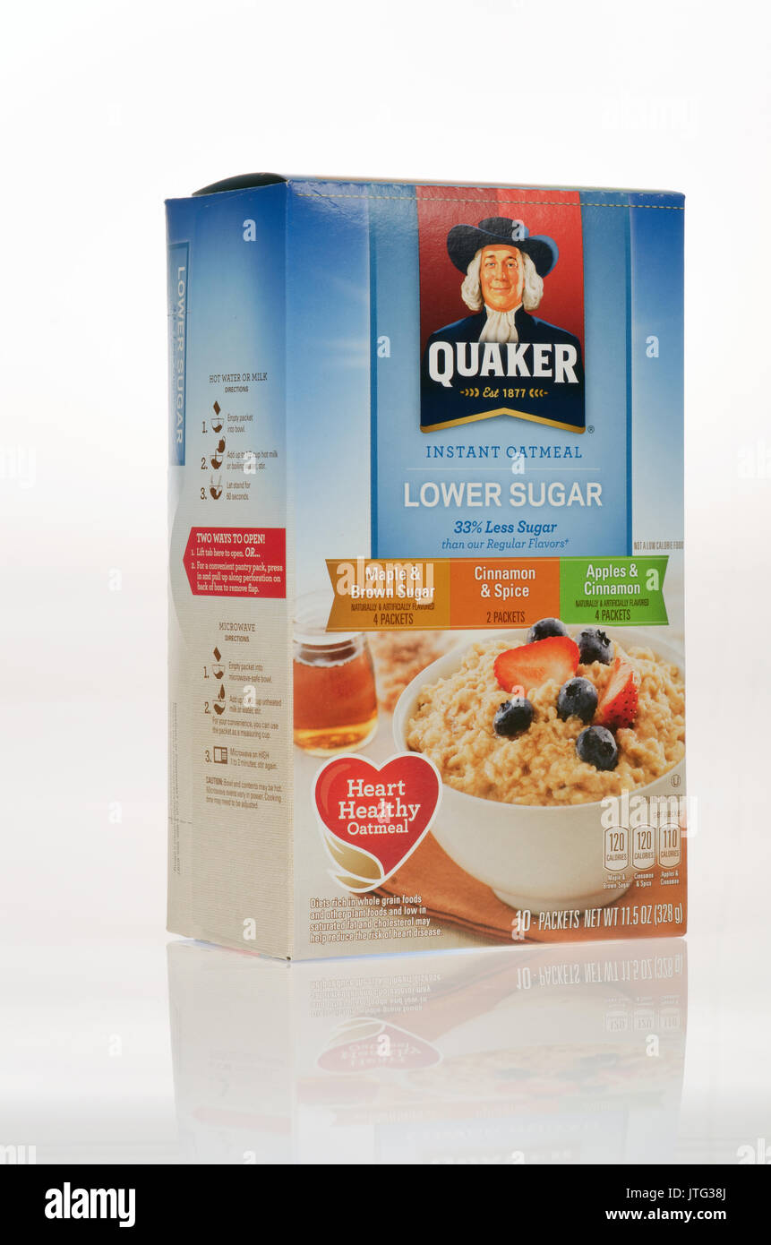 Unopened variety box of Quaker Instant Oatmeal Lower Sugar on white background, cut-out. - Stock Image