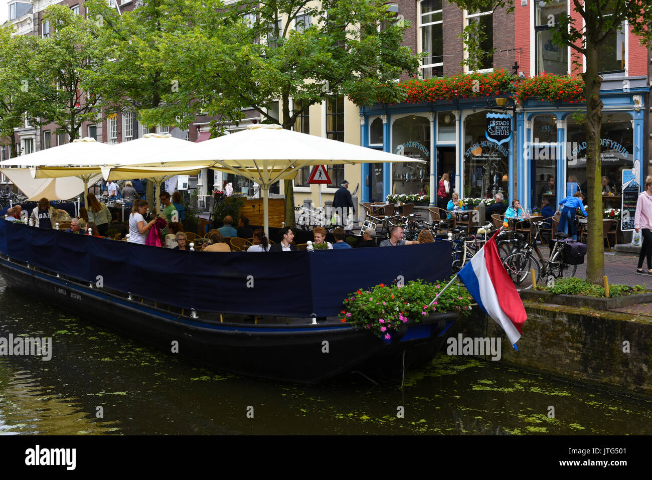 People eating on a Canal Barge Restaurant in Delft, South Holland, The Netherlands - Stock Image