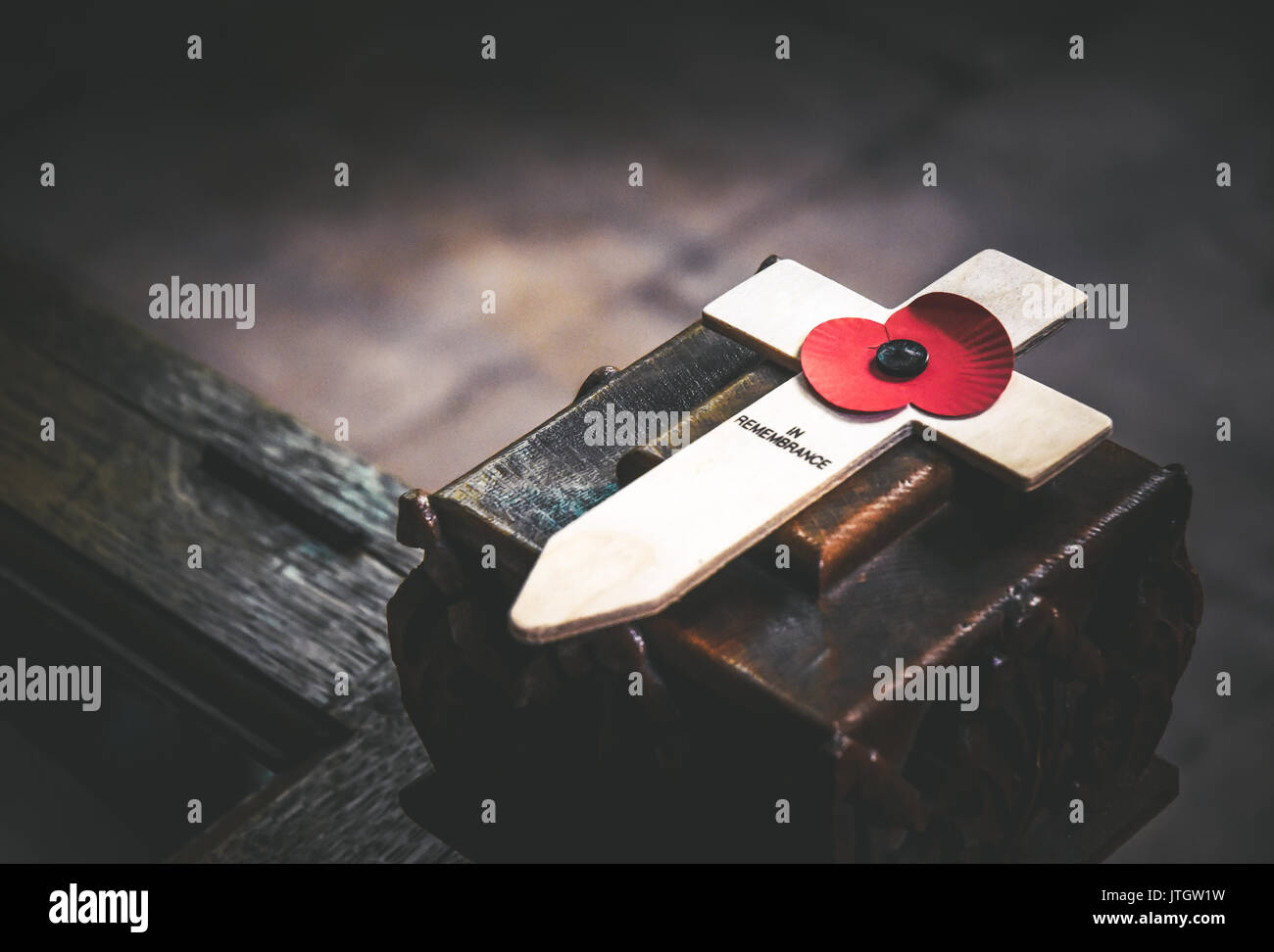 A remembrance poppy cross situtated inside Lichfield Cathedral, Staffordshire, England - Stock Image