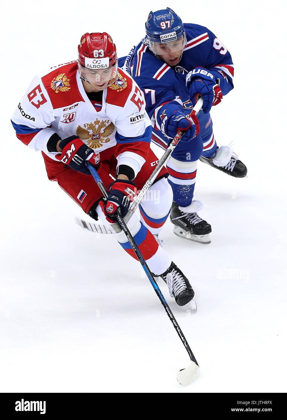 Sochi, Russia. 9th Aug, 2017. Russian Olympic team's Pavel Kraskovsky (L) and HC SKA St Petersburg's Nikita Gusev fight for the puck in their Sochi Hockey Open 2017 final match at the Bolshoi Ice Palace. Credit: Artyom Korotayev/TASS/Alamy Live News - Stock Image
