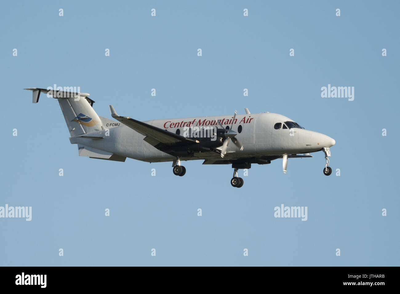 June 10, 2017 - Richmond, British Columbia, Canada - A Central Mountain Air Beech 1900D (C-FCMU) airplane on final approach for landing at Vancouver International Airport. (Credit Image: © Bayne Stanley via ZUMA Wire) - Stock Image