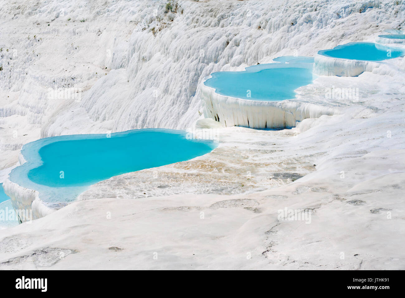 Natural travertine pools and terraces, Pamukkale, Turkey - Stock Image