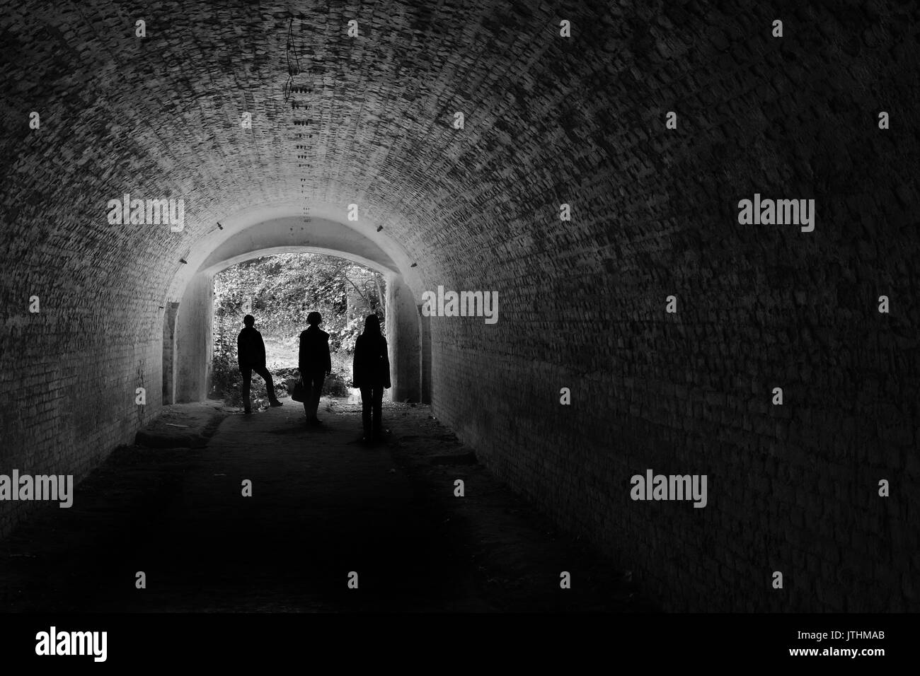 Three persons found exit from catacombs - Stock Image