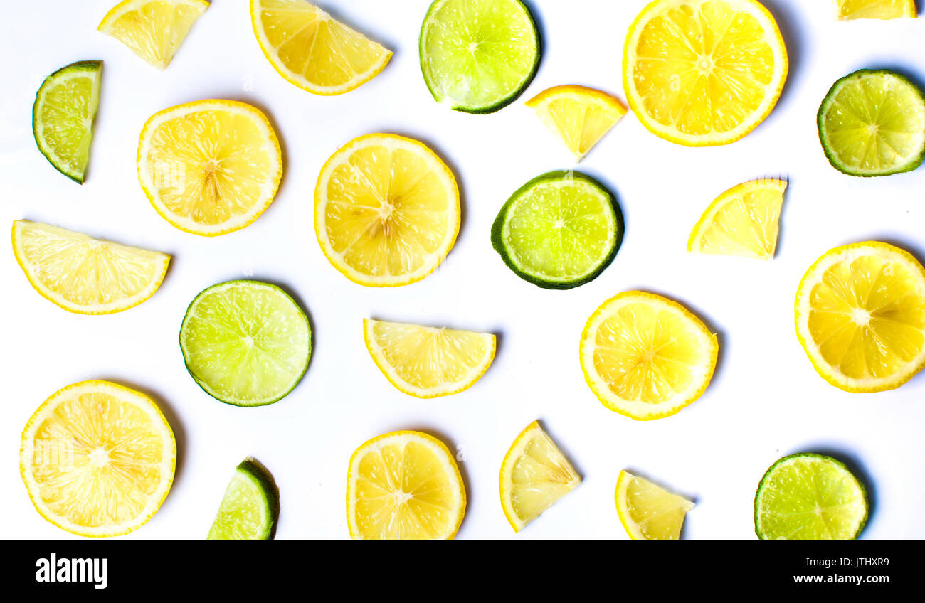 Lemon and lime slices on white background - Stock Image