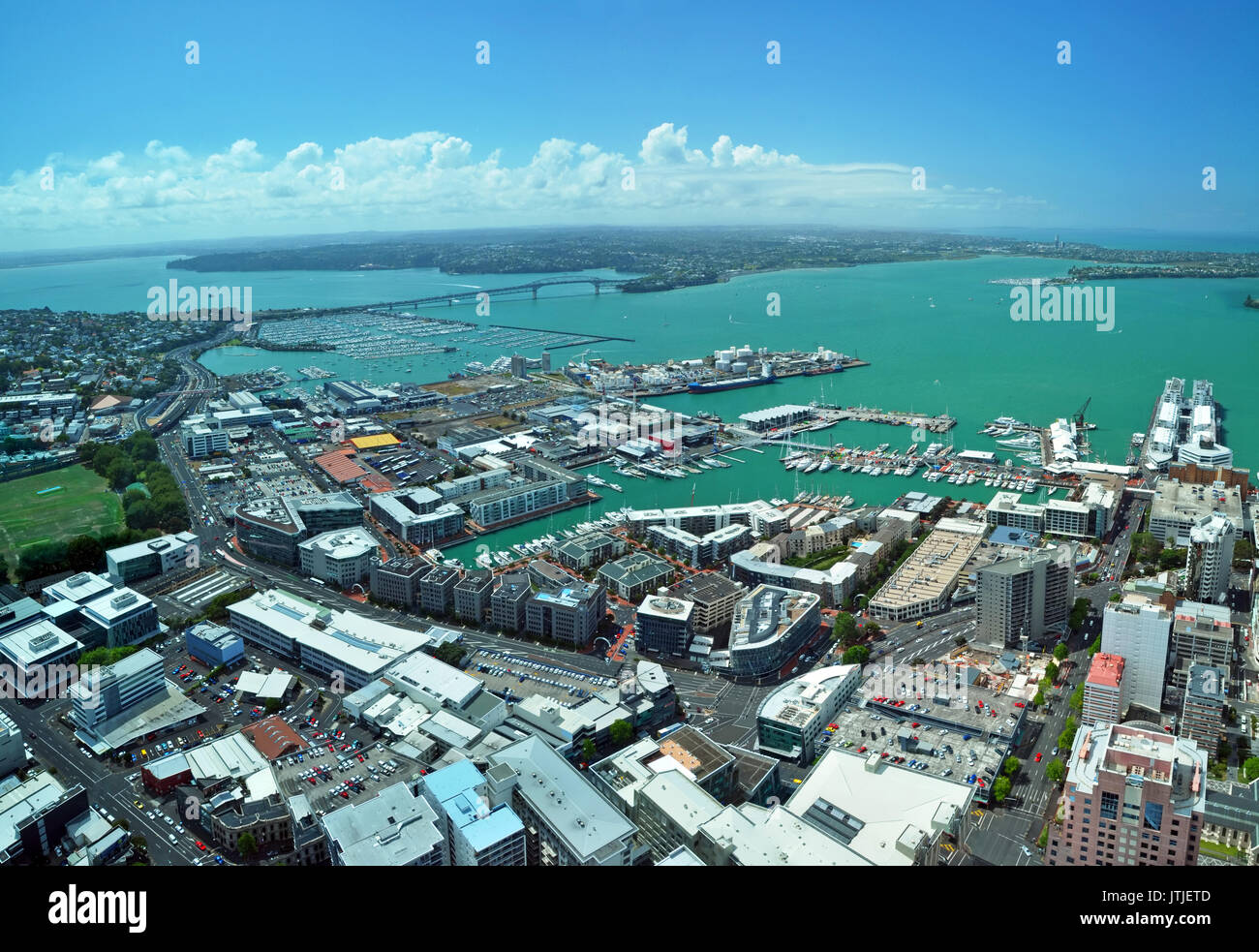 Panoramic aerial view of Auckland City &  Waitemata Harbour looking northwest to the  iconic Auckland Harbour Bridge in the distance. In the foregroun - Stock Image