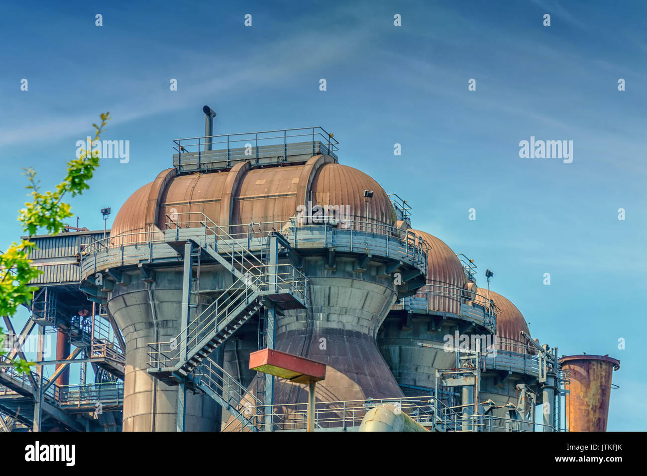 General view of an industrial plant refinery, consisting of pipes and towers of heavy industry. Stock Photo