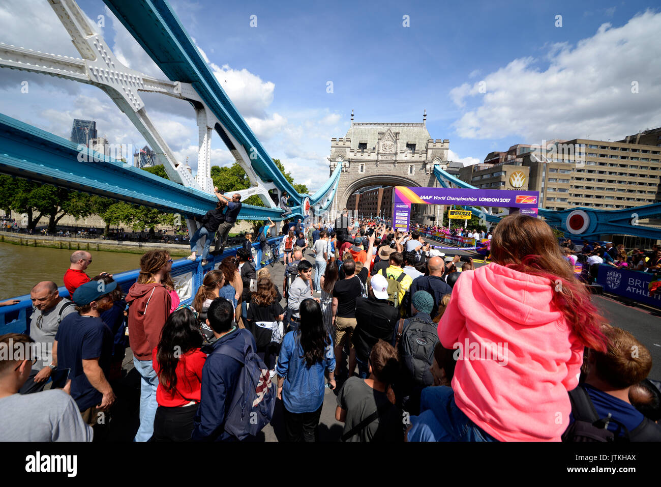 Crowds pack Tower Bridge for the finish of the World Athletics Championships Marathon, London. Space for copy - Stock Image