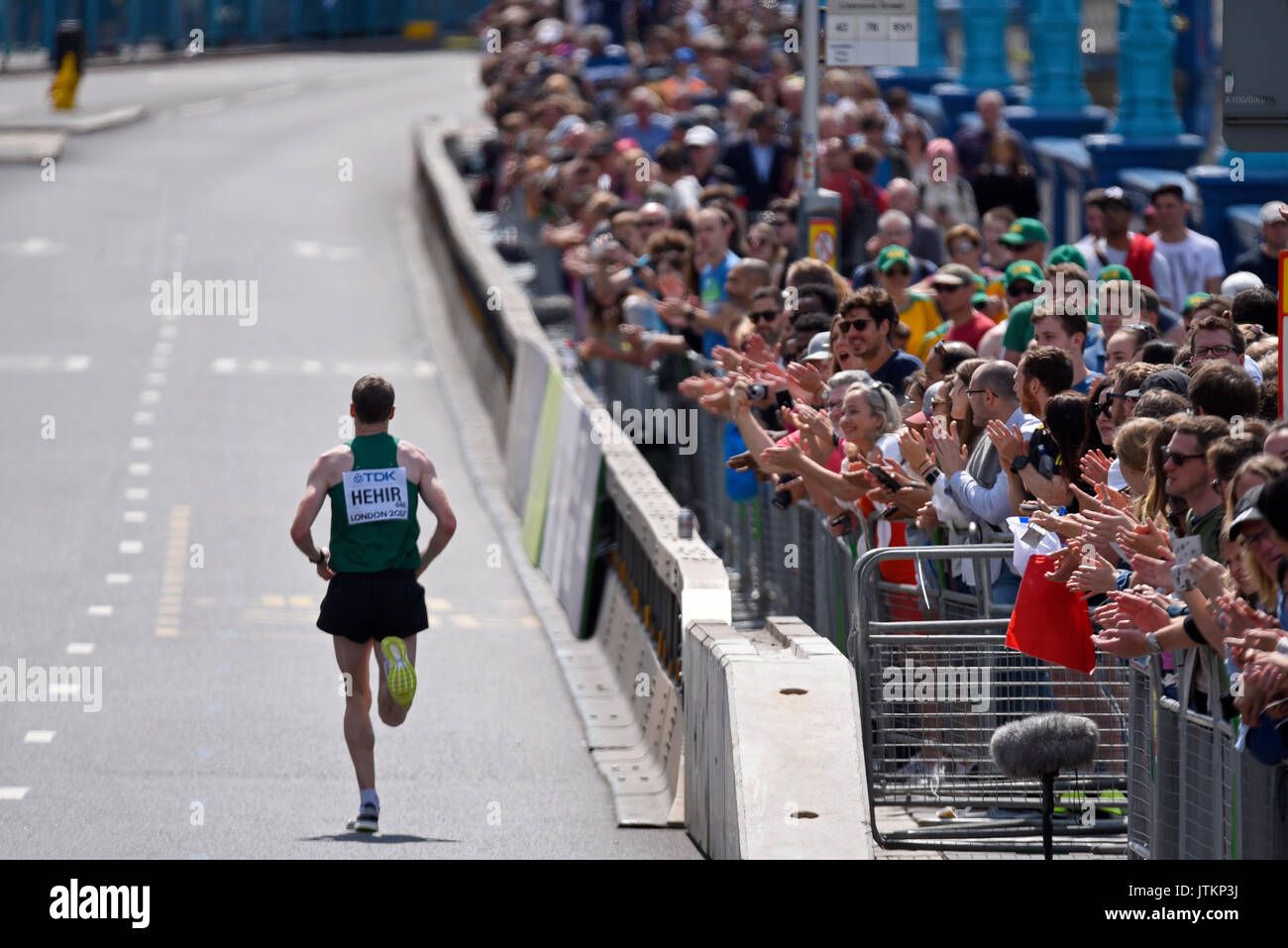 Sean Hehir of Ireland heading towards the finish line on Tower Bridge during the World Championships Marathon 2017 in London. Crowds. Space for copy - Stock Image