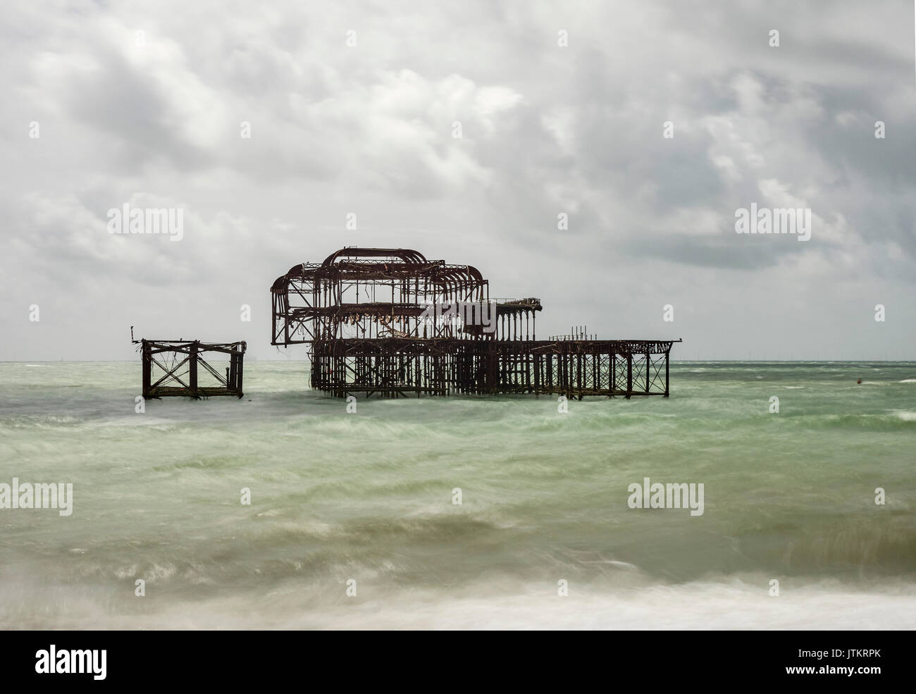 Brighton beach and the remains off the West pier long exposure East Sussex - Stock Image