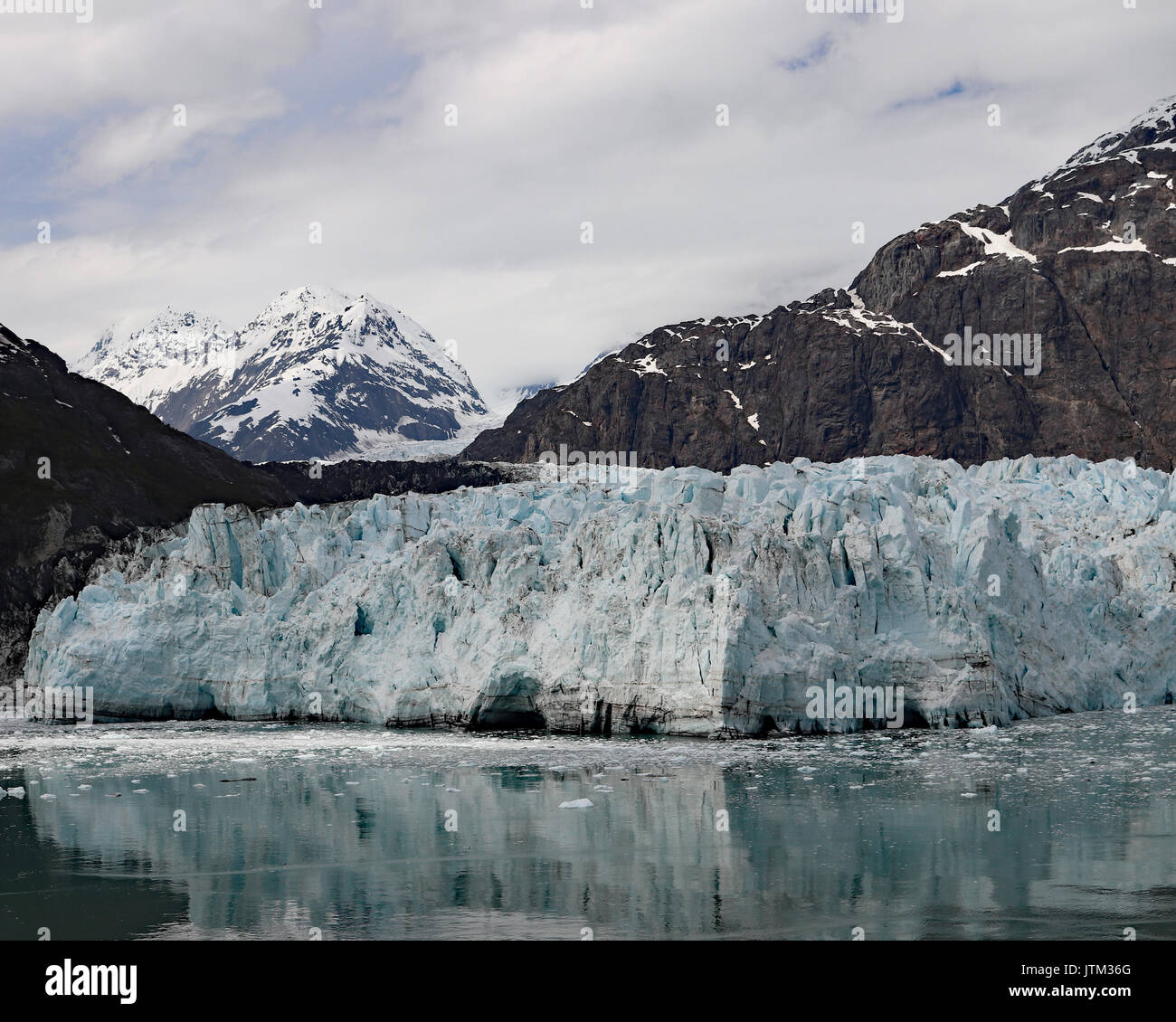 Margerie Glacier is one of the few advancing glaciers in Glacier Bay National Park, Alaska. It grows approximately 30 feet per year - Stock Image