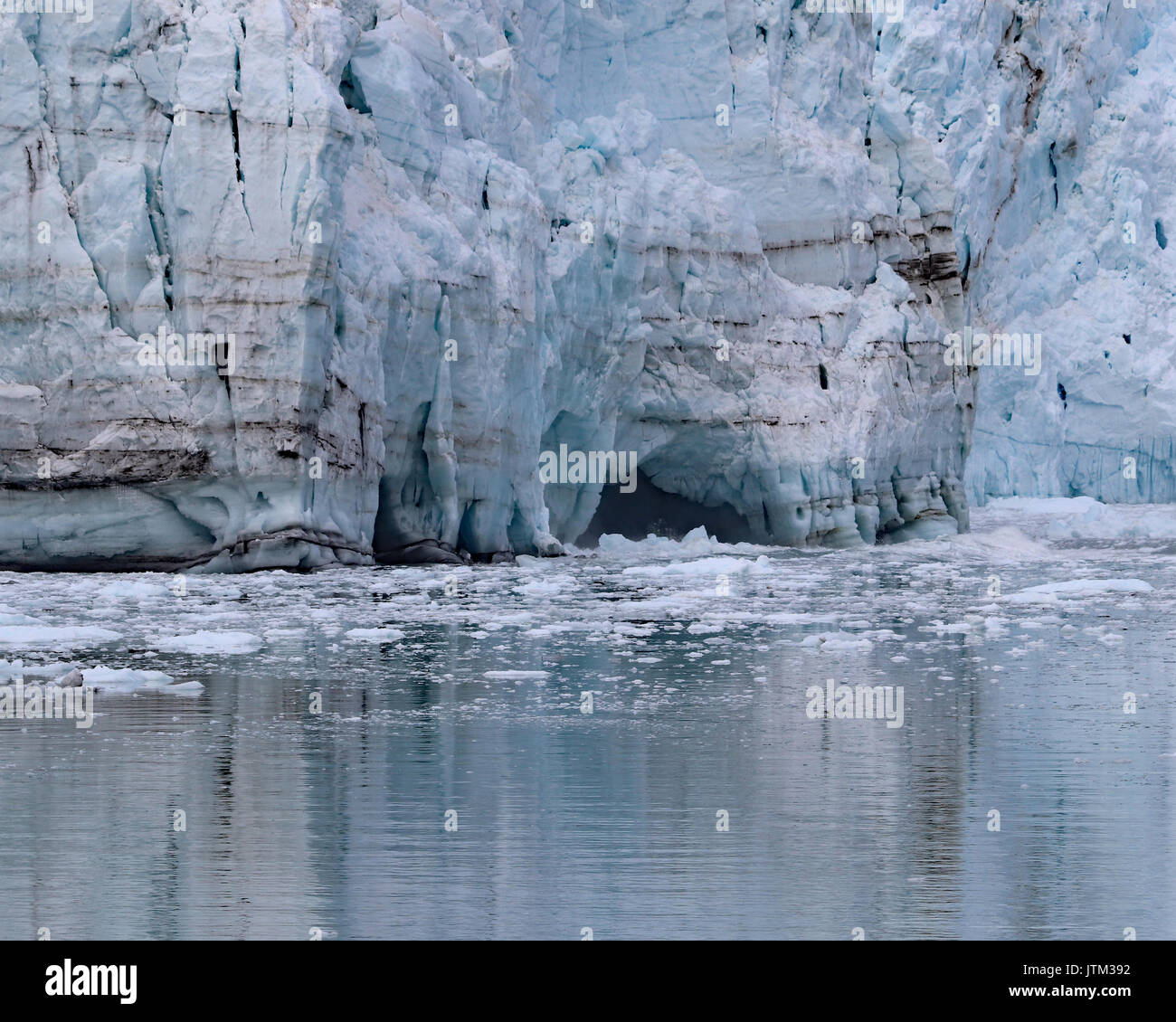 Margerie Glacier details at the water where caves form - Stock Image