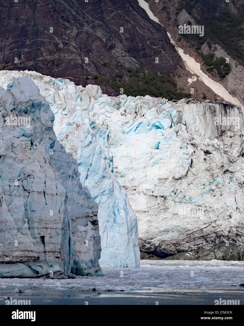 The Margerie glacier grows at a pace of 30 feet per year and is one of the few advancing glaciers in Alaska - Stock Image