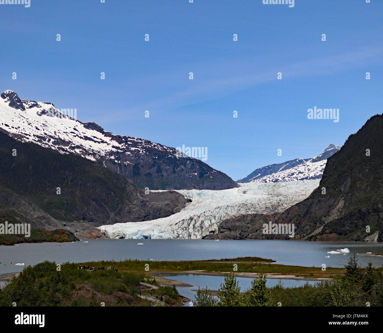 Mendenhall Glacier used to be called Sitaantaggo 'The glacier behind the town' and also Aak'wtaaksit 'The glacier behind little lake' - Stock Image