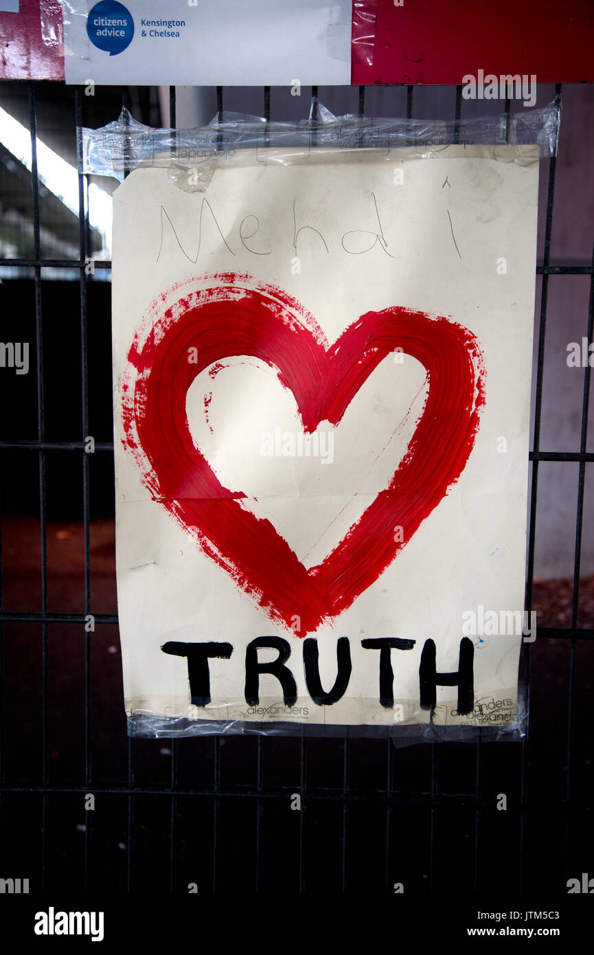 Grenfell Tower, West London. Aftermath of the tragedy. Poster with a heart saying Truth - Stock Image