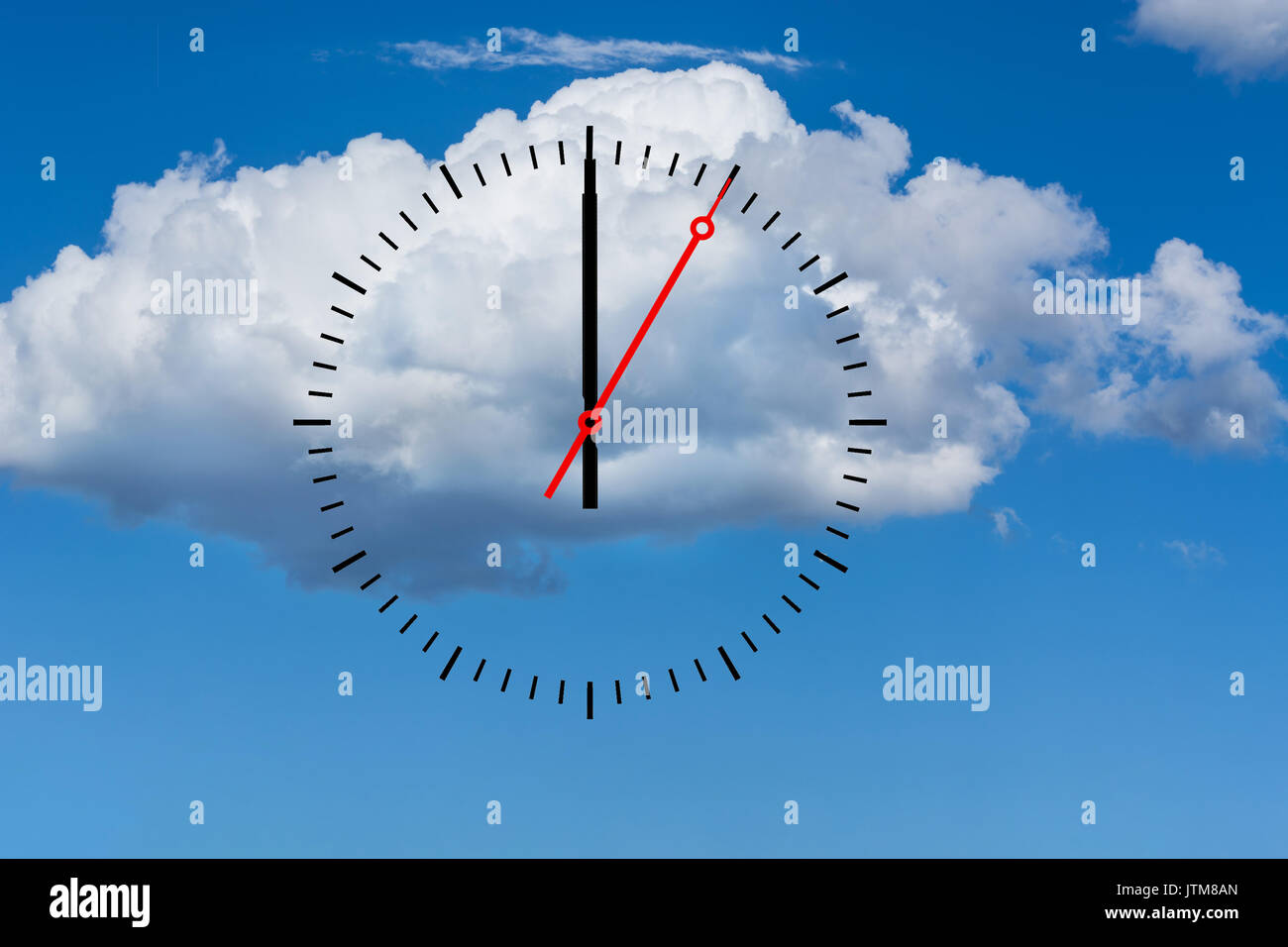 Clock, dial with a minute hand and a red second hand indicates 12 o'clock. Copy space in front of sky and cloud background. - Stock Image