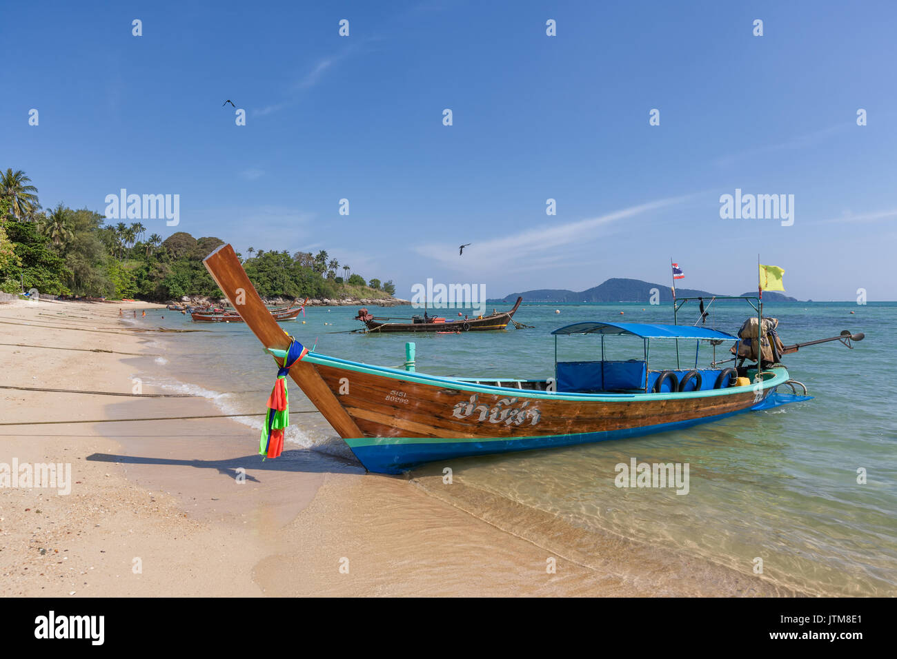 Traditional longtail fishing boats moored at Rawai Beach, Phuket, Thailand - Stock Image