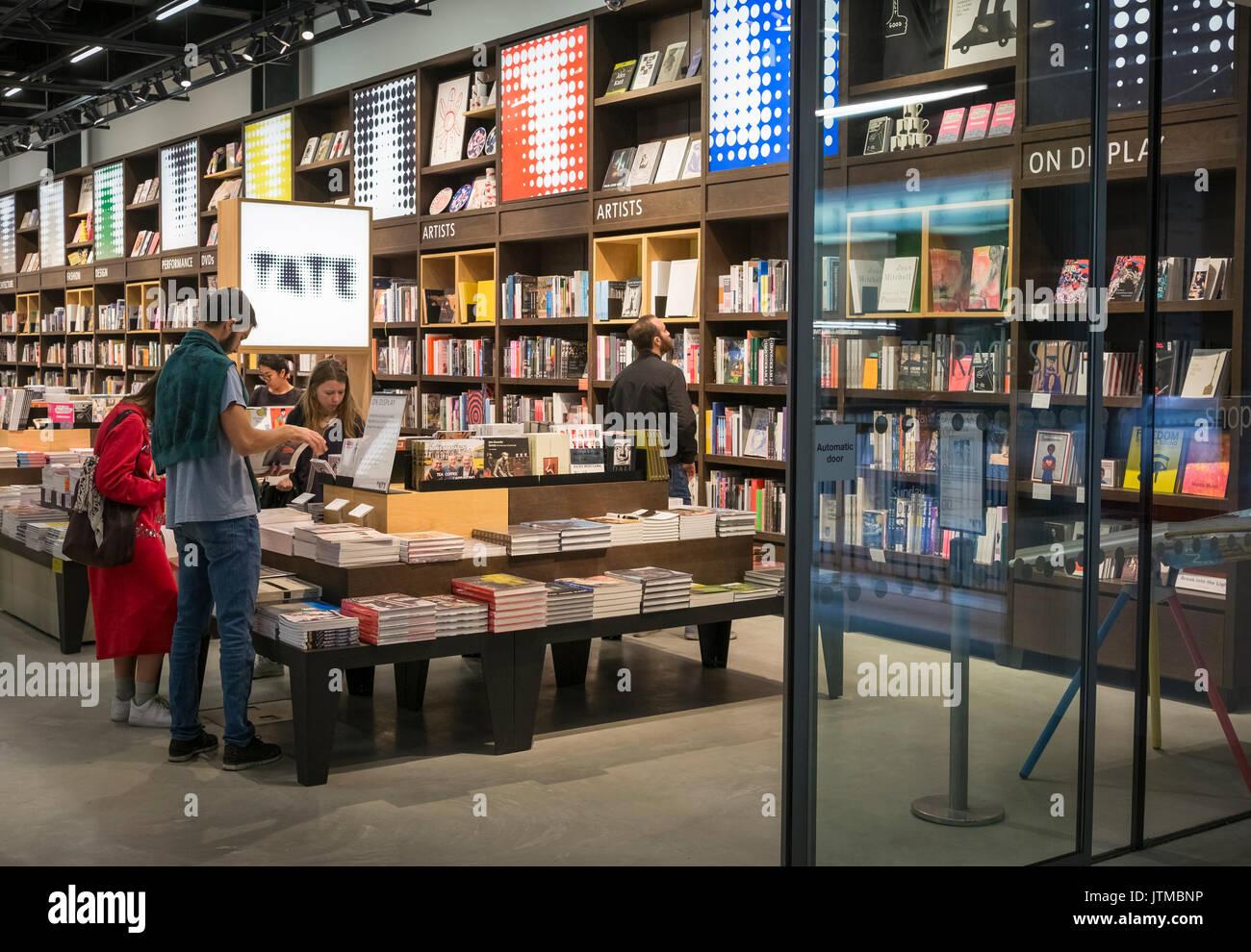 People browsing arts bookstore, London, England UK - Stock Image