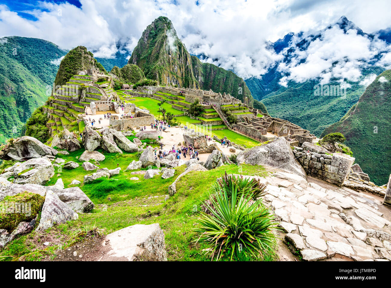 Machu Picchu in Peru with ruins of Inca Empire Huaynapicchu Mountain in Sacred Valley Cusco heritage of South America. - Stock Image