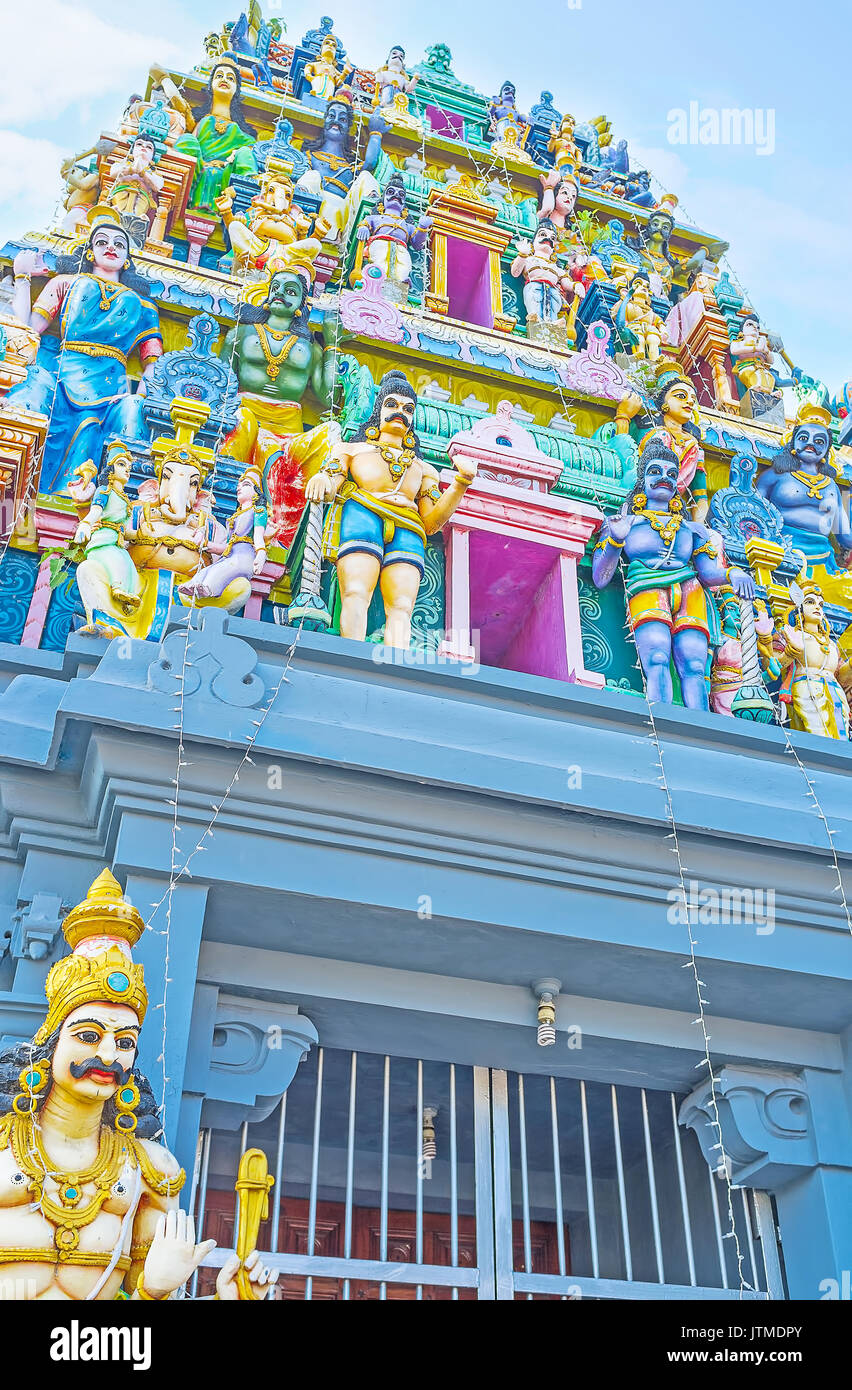 Details of Gopuram tower of Kali Amman Temple in Negombo, the sculptures of Hindu deities, painted in bright colors, Sri Lanka. - Stock Image
