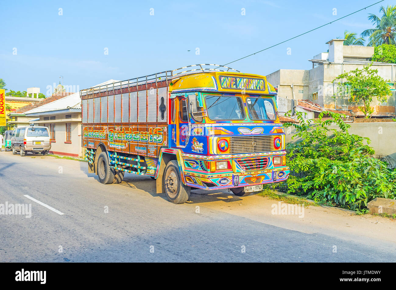NEGOMBO, SRI LANKA - DECEMBER 7, 2016: The bright painted  truck is parked by the road in residential neighborhood, Stock Photo