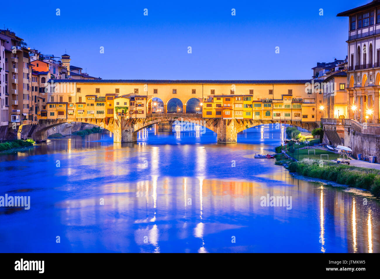 Florence, Tuscany - Ponte Vecchio,  medieval stone arch bridge over the Arno River, Renaissance architecture in Italy. - Stock Image