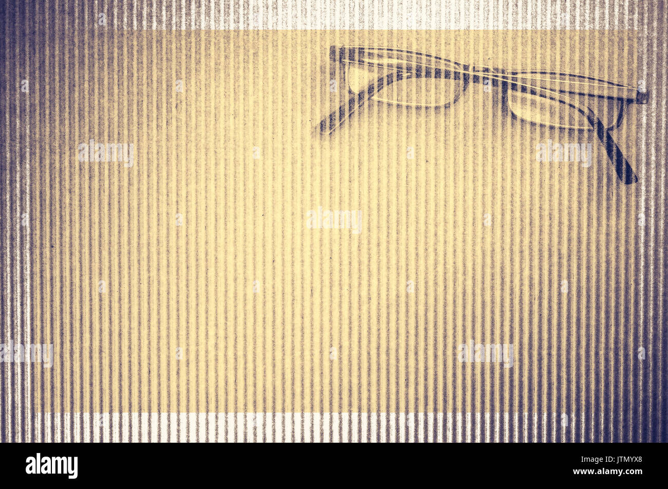 eyeglasses textured wavy cardboard surface background - copy space - Stock Image