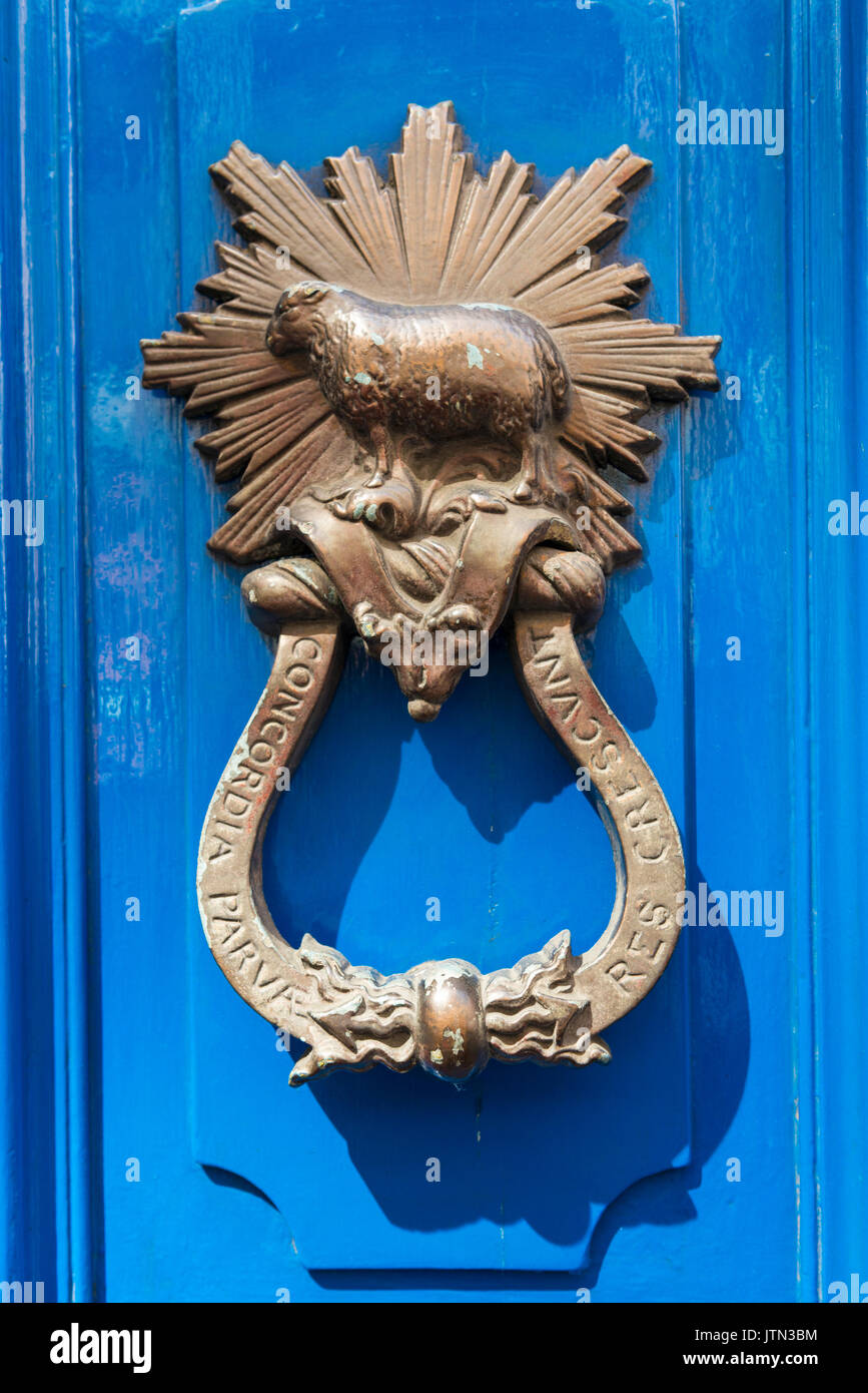 UK City of London Financial District ornate door knocker furniture sun burst sheep inscription Concordia Parvae Res Crescunt Unity Makes Strength - Stock Image